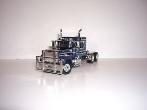 DCP FIRST GEAR 1/64 DARK BLUE AND BLACK MACK SUPER-LINER WITH 60'' SLEEPER