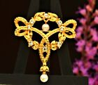 MONET signed  elegant gold tone faux pearls clear rhinestones love knot  BROOCH
