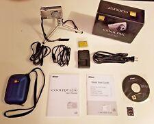 Nikon COOLPIX S230 10.0MP Digital Camera Bundle w/ 2GB SD Card, Case, and Tripod