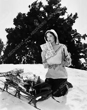 8b20-0477 Maureen O'Sullivan hauls Christmas presents through snow on sled 8b20-