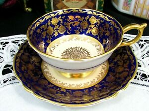 PARAGON COBALT BLUE GOLD GILT FLORAL WIDE TEA CUP AND SAUCER