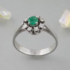 Ring mit ca. 0,41ct Smaragd + Diamanten in 585/14k Weißgold