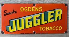 """Vintage Odgen's Juggler Tobacco 22"""" x 10"""" Porcelain Enamel Sign."""