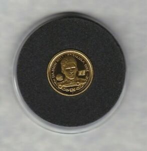 1994 LIBERIA DAMON HILL GOLD 20 DOLLARS COIN IN MINT CONDITION WITH A CAPSULE