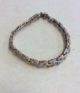 "7.5"" Gold Over Sterling Silver Bracelet In A Step Or Herring Bone Pattern"