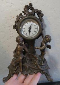 Bronze patinated Mantel flying Cherubs putto Clock enamel rose Baroque style