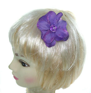 small purple hair flower with gem center on a small clip