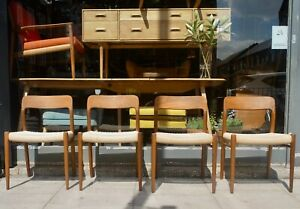A set of four vintage 1970s Danish Moller 75 dining chairs with paper cord seats