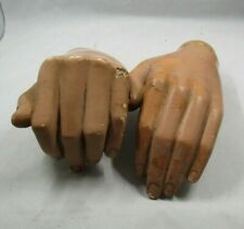 Two glass fibre hands from mannequins. Both left hands.