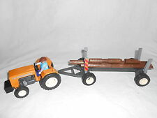 Ref. 4209 bucheron sur son tracteur + remorque bois