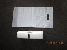 100 WHITE PLASTIC BAGS / GIFT SHOP CARRIER BAG / BOUTIQUE RETAIL 23CMS X 44CMS