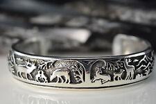 Sterling Silver Navajo Designed shadowboxed Deer, elk, Bear cuff style Bracelet