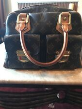 Louis Vuitton Manhattan PM Handbag Satchel preowned. Some wear on edges.