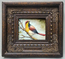 Miniature oil painting beautiful colorful bird on tree branch in ornate frame