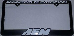 "AEM 10-400W License Plate Frame Surround Black ""ENGINEERED TO OUTPERFORM"" + Logo"