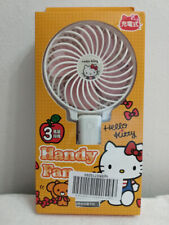 HELLO KITTY RECHARGEBLE HANDY FAN WITH DEDICATED STAND..NEW IN BOX FROM JAPAN. N