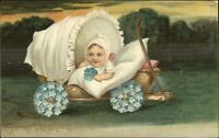 Valentine Cute Baby in Wagon Carriage w/ Flower Wheels c1910 Postcard