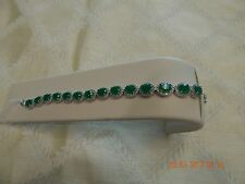 Rhodium plated copper bracelet with green cubic zirconia stones, white CZ accent