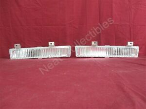 """NOS OEM Oldsmobile FWD """"98"""" Bumper Mounted Park Turn Signal 1986 - 90 Clear PAIR"""