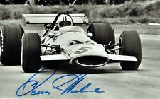 DENNY HULME -   Signed B/W action photograph in the Mclaren Ford