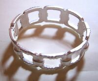 Lovely silver tone metal cuff style bracelet hinged with great link design