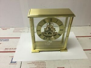 "Howard Miller  Clock 845-622  Glass Case Polished Brass Disney Cast 8"" tall"