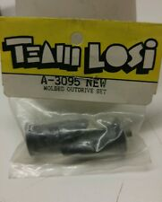 Vintage losi molded outdrive set. a-3095