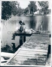 1961 Idyllic Couple Lean Against Each Other on Dock Press Photo