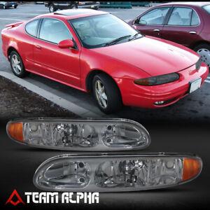 Fits 1999-2004 Oldsmobile Alero [Chrome/Smoke] Amber Corner Headlight Headlamp