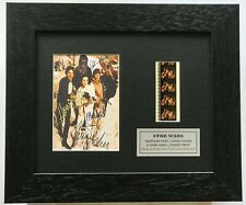 More details for star wars carrie fisher, harrison ford & mark hamill signed repro filmcell