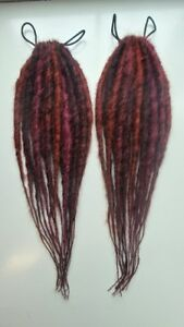 Reversible dread falls. Mix of auburns and coppers,18 dreads per fall.