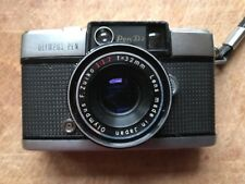 Olympus Pen D3 half-frame camera with fast 32mm f1.7 lens.