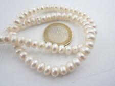 1 filo di perle bianche australiane schiacciate di 6,5 x 4  mm lungo 37 cm