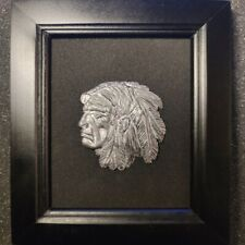 Tin bas-relief,Native American, in a frame.