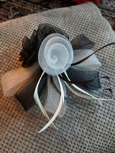 Fascinator Black & White Feather. Clasp Fastening. New.