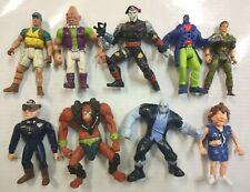 9 FIGURE LOT 80's 90s Jurassic Park GI Joe He-man Beetlejuice DC Police Academy
