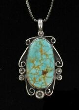 carved sterling on chain marked Beautiful Vintage Turquoise Pendant bordered in