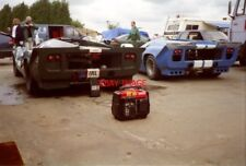 PHOTO  TWO LOLA T70S AT REST IN THE PADDOCK PRIOR TO THE PRE-72 LE MANS CARS RAC