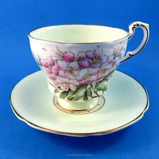 Handpainted Pink Florals with a Green Interior Paragon Tea Cup and Saucer Set