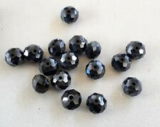 19 opaque metallic black rondelle faceted beads 10 x 7mm. Lovely beads!
