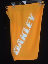 Men's orange and white Oakley board shorts  Size 31 inseam 11 New with Tags