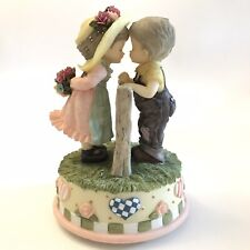 Boy and Girl Kissing Figurine Music Box Gray Haired Children Anniversary Gift