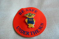 Marie Curie cancer care charity bear Mexican hat pin lapel badge