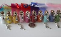 Small Bottles Fairy / Elf Glitter Dust - with Fairy on a Clasp & Bag. 28x16mm.