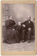 WELL DRESSED MAN AND WIFE AT TABLE WITH BOOKS ANTIQUE CABINET CARD