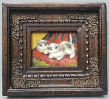 Miniature oil painting of two beautiful cute cats are playing in ornate frame