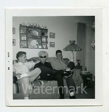 1960s  Square snapshot Photo Teen Guys on couch  Guy with  wig sunglasses