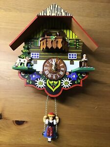 GERMAN BLACK FOREST CLOCK with SWINGING GIRL