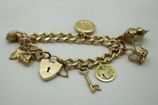 Heavy 9ct Gold Patterned Curb Link  Bracelet With Heart Padlock With 8 Charms