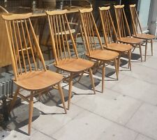 A set of six 1970s vintage Ercol 'goldsmith' dining chairs.
